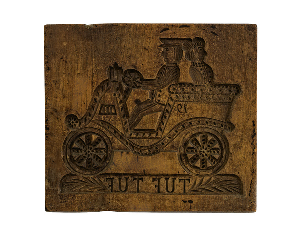 Wooden Bread Mold: An old woodcut made to press a design into the dough of baked goods. This one is authentic for the early 1900's. It even has worm holes in the wood. On the back side