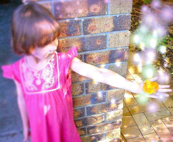 Magical Morning: A child with Easter chicks in her hand surrounded by fantasy lights. You may prefer:  http://www.rgbstock.com/photo/mqRO8AW/Jellybean+Heaven  or:  http://www.rgbstock.com/photo/mjmKWLW/Twin+Girls