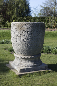 Ornamental urn: A large ornamental stone urn in a garden in West Sussex, England.