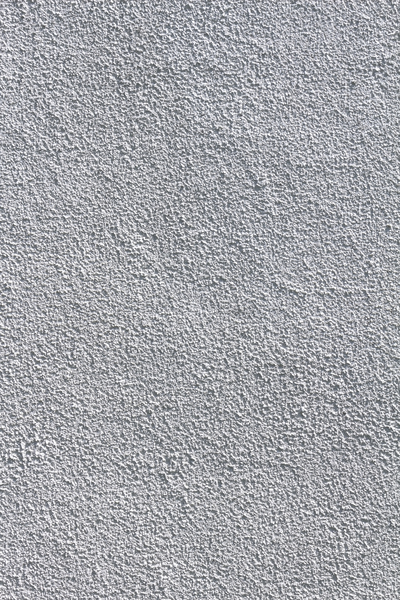 Plaster texture: Rough exterior plaster painted white.