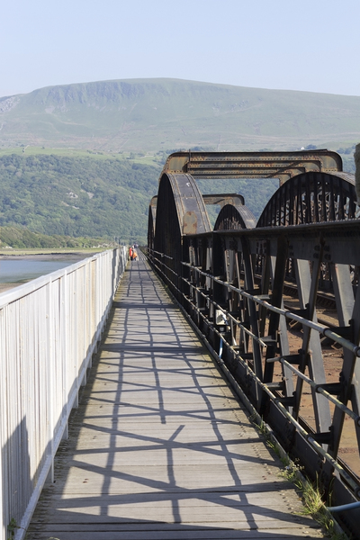 Railway bridge: A railway bridge and causeway with pedestrian walkway at Barmouth, Wales.