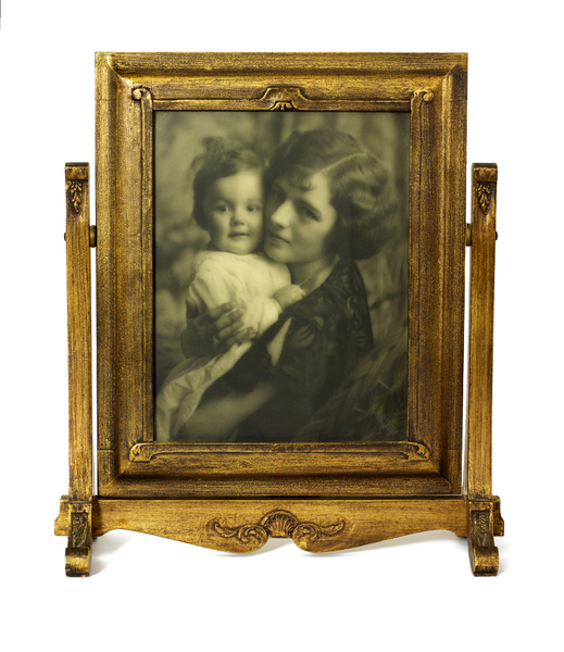 Frame with Photo: Old gold gilded frame on swivel stand. 