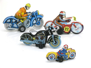 Tin toys: Tin toys, four motorcycles, black one sharp focus, others blur