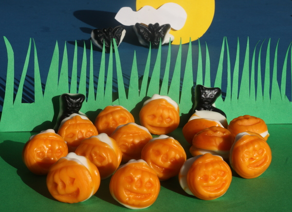 Pumpkin field under full moon: Pumpkin field with cats and vampires flying to the moon.