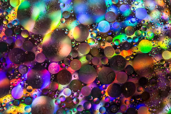 Galaxy Far Far Away: Close-up of olive oil floating in water.... reminds me of planets in another galaxy