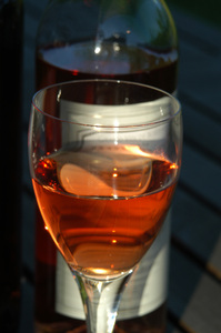 A glass of rose wine playing w