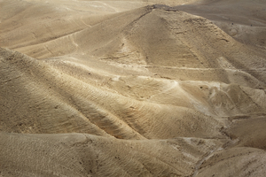 Desert: Limestone desert landscape in the Mt. Azazel area, Israel, with two cyclists in the distance (top right).