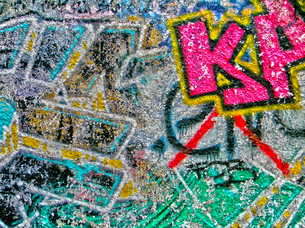 Graffiti: Colorful graffiti on the wall of the school.