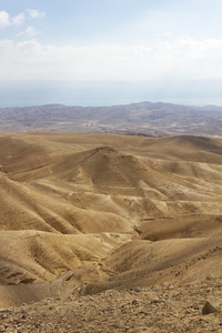 Israel desert: The Judean desert, Israel, with the Dead Sea visible in the background.