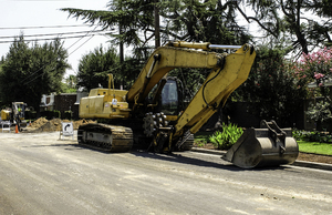 Excavator : Machines used to install new water main under street.