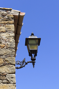 Old streetlamp: An old streetlamp in a village in Catalunya, Spain.