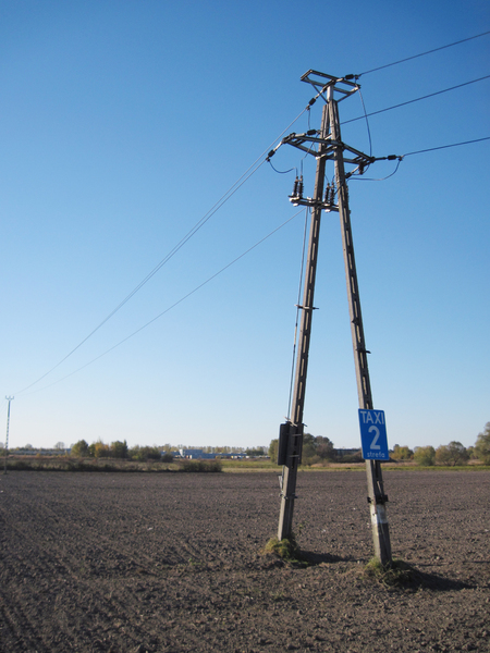 Electric pylon: A pylon among the fields. Weird taxi zone sign.