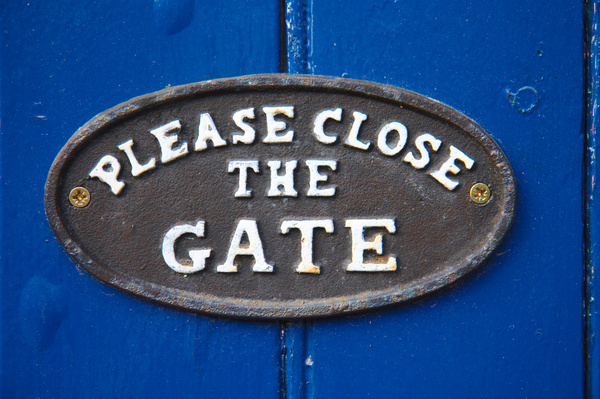 Close the Gate!: Close the Gate text on a blue garden gate