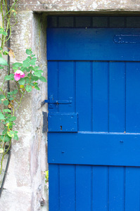 Blue gate: Blue painted gate leading into garden through stone wall