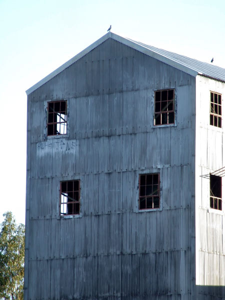 derelict3: old multi-storey abandoned corrugated iron factory shed