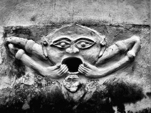 The daemons...: Spit them out- the demons...Haunting  sculpture; bottom wall of a buddhist temple Laos (Luang Prabang, Vat Pak Khan Khammungkhun).