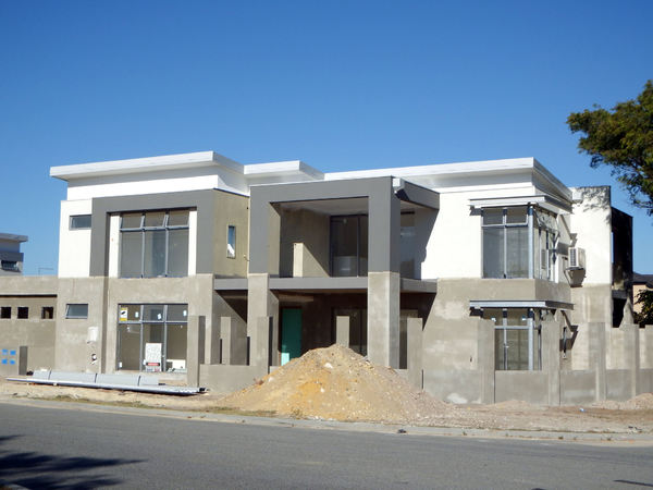 squared construction1: construction of squarish two-storey suburban home units