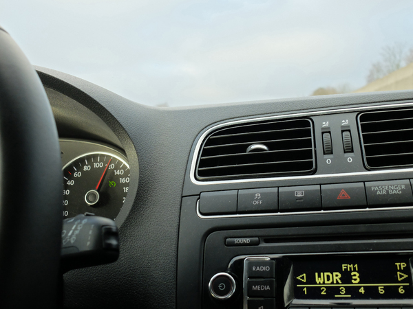 Cruise Control: Dashboard of a car @ 120 km/h, Radio is playing