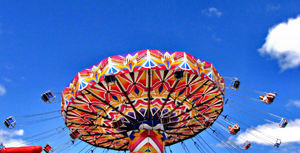 around in circles7b: colourful rotating fairground rides