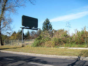 Billboard: A billboard by the road.