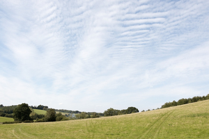 Landscape and sky: Rural landscape in the Surrey Hills, England.