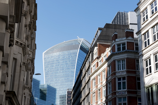 New and old architecture: Modern skyscrapers and historical buildings in London, England.