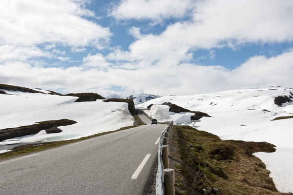 Snow road: A road through a high snowy plateau in Norway.