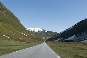 Road through a valley: A road through a glacier-carved valley in Norway.