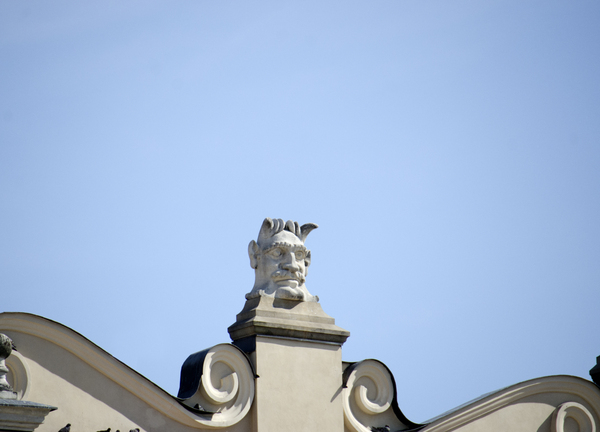 stone head on top of building