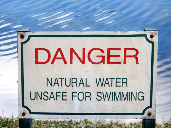 naturally dangerous1: sign warning of water danger