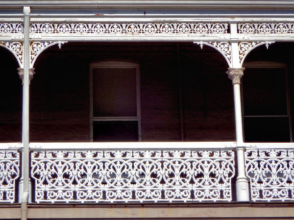 decorated balconies7: balcony safety railing in delicate and artistic wrought iron in an Australian style known as Paddington lace
