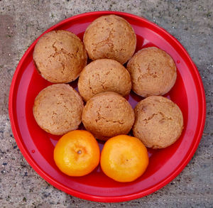 mandarin muffins1: plate of freshly baked mandarin flavoured muffins - cupcakes