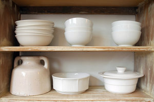 Simple crockery: Simple, plain white crockery.NB: Credit to read