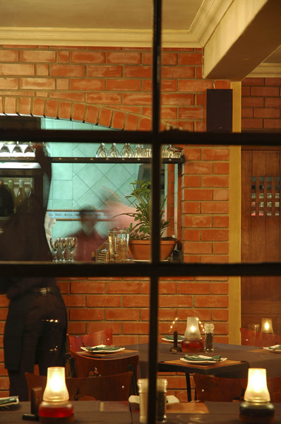 Bistro: Through the window of a preparing restaurant.NB: Credit to read