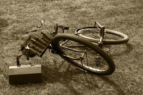 Abandoned WW2 bicycle: A WW2 military bicycle. The photo was originally shot in colour. Using a high contrast blue filter the image was adjusted to black and white and given an atmospheric sepia like tint.