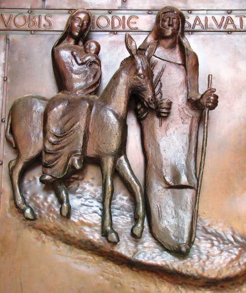 bronze image: Biblical motifs on a cathedral gate (Holy family)