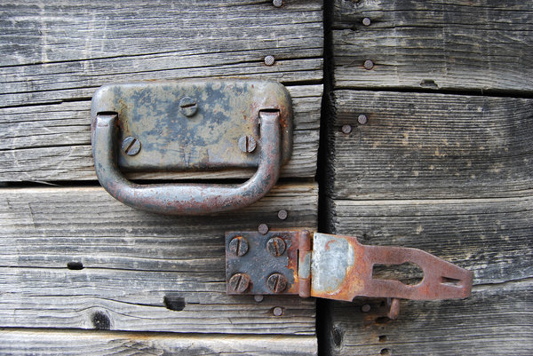 Wood door 4: rusty latch on old wood door - Italy - Tarvisio