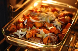 Roasted dinner: Potatoes and onions roasted in the oven with some chicken pieces