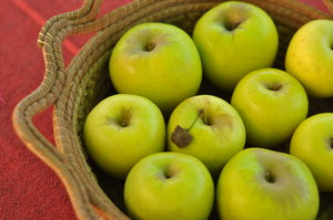 Apples in basket: Green apples in hand made basket