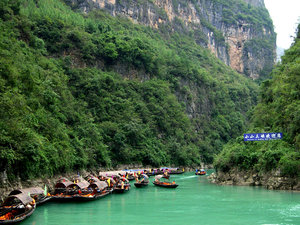 Tourist boats: Tourist boats on the Mini Three Gorges in China, waiting to take passengers on a sightseeing tour through the gorges.