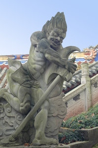 Demon: One of the statues depicting a demon in the Ghost City near Fengdu, China.