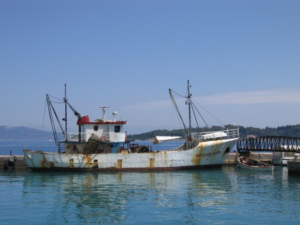 Fishing boat: A fishing boat in the harbor of a Greek island.