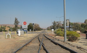 South from Alice springs: Rail line leaving Alice Springs Station, Central Australia, heading South toward Heavitree Gap and on toward Adelaide, South Australia.