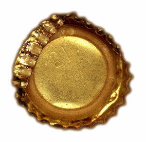 Crushed: A flat, crushed underside of a vintage bottle cap.Please visit my stockxpert gallery:http://www.stockxpert.com ..