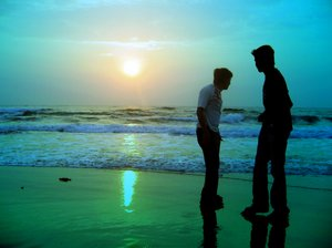 Beach friends 2: Silhouette of two friends on the beach