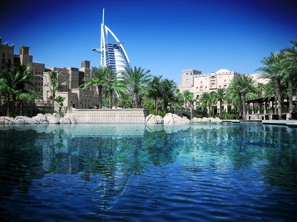Architecture and reflection: View of the Burj al arab against the quaid madinat jumeirah. This is an architectural photograph