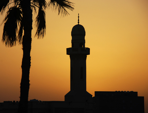 Minaret at Sunset 1: A minaret and palm tree silhouetted at sunset