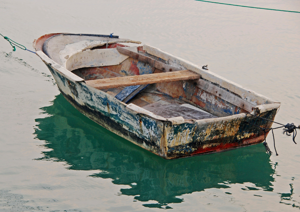 Dilapidated Boat: A weather beaten and dilapidated row boat