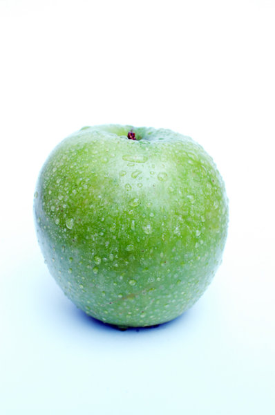 Green apple with waterdrops.: A fresh tasteful green apple with some waterdrops ... get a bite!