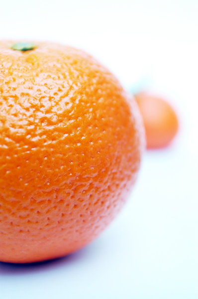 Orange with mandarin.: A orange with a mandarin on the background.